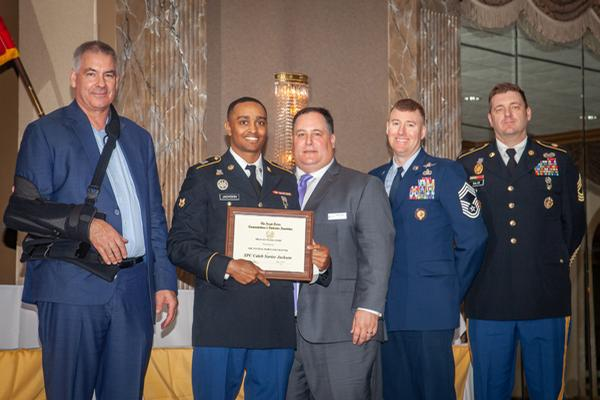 Chapter leaders present the military scholarship at the annual awards night in May.