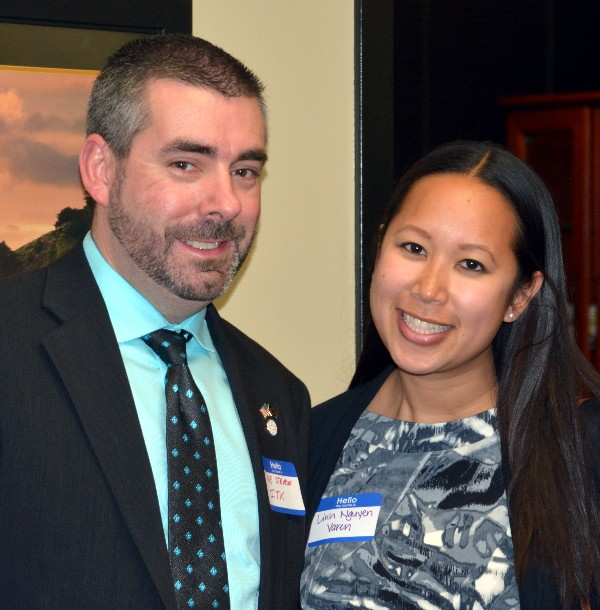 Rob Stevens, InfoTek, and Linh Nguyen, Varen Technologies, network at the WIIG event in December.