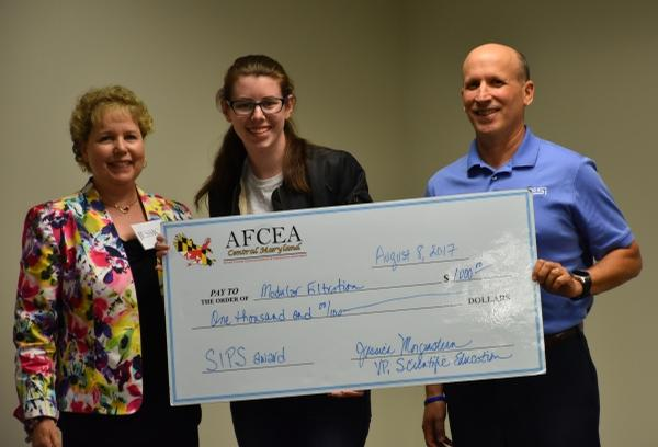 Morgenstern and Rosen present Anna Blendermann with her Best Technical Project award at the Summer Intern Presentation Showcase in August.