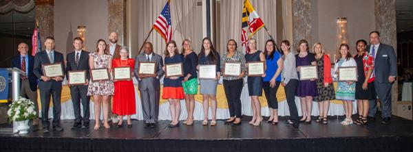 Recipients of the chapter's K-12 grants pause for a photo at the May awards night.