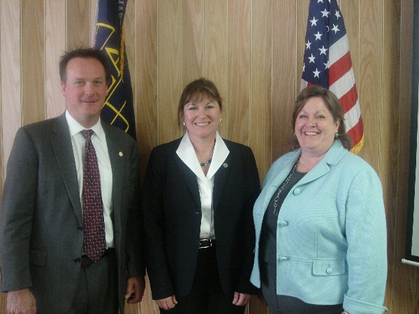 In November, Adrian Felts, chapter president, and Debra Harvey (r), chapter executive vice president, welcome guest speaker the Honorable Terrie Suit, secretary of homeland defense and veterans' affairs, Commonwealth of Virginia.