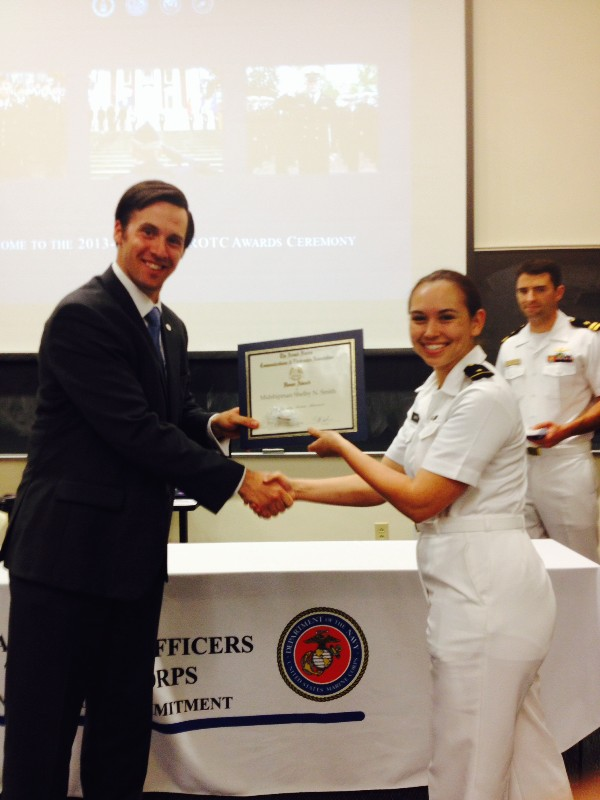 In April, Midshipman Shelby Smith, Navy ROTC, accepts an ROTC Award from Reagan.