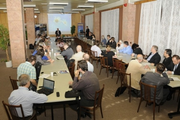 In June, experts listen to a speaker at the 47th Security Seminar, focused on Multimedia Communication & Security.