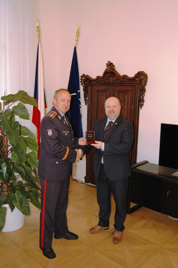 Maj. Gen. Jan Kase, chief of staff of the Military Office of the President of the Czech Republic, receives the Medal of Merit Award from Petr Jirasek, regional vice president, Central Eastern Europe, at the November meeting.