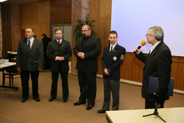 In November, Josef Požár (l), dean of faculty of security management, National Police Academy; Josef Strelec (r), chapter president; and Oldřich Krulk (2nd from l), student chapter president, present grants to Petr Pacher (c) and Alexandr Strach in recognition of their outstanding efforts in education.