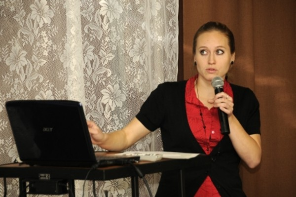Alena Pejcochova, a student at the Police Academy, Czech Republic, speaks on cell phones as evidence in crime investigations during the Security Seminar in June.