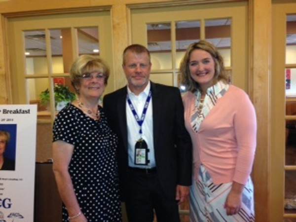 Claire Revalee, chapter Young AFCEAN vice president (r) greets Todd Vikan of TACG, The Ahrens Consulting Group, and Lynn Moad, former division chief of the Air Force Materiel Command�s Systems Integration Division, during the chapter�s Young AFCEAN Power Breakfast in July.