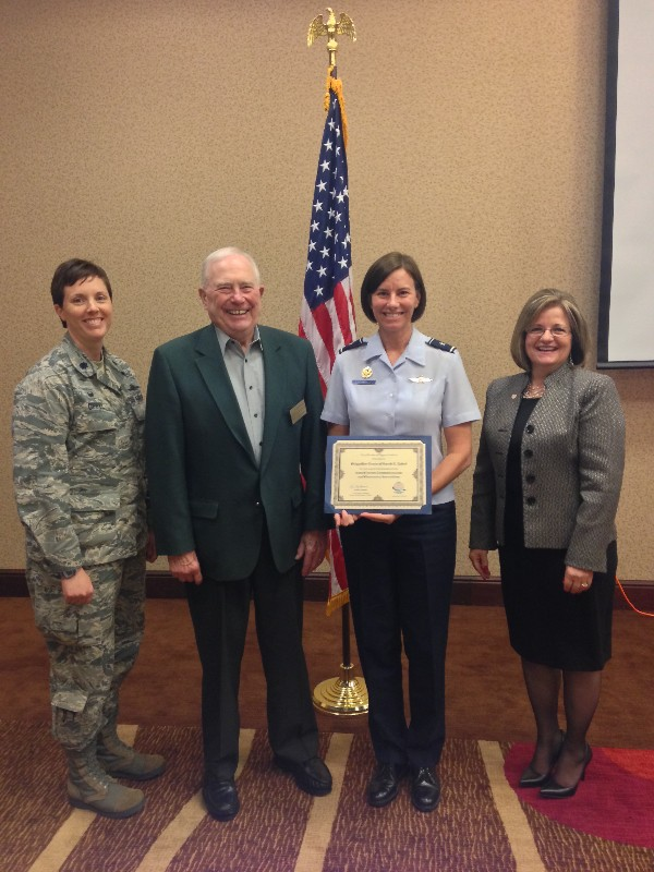 Lt. Col. Brenda Oppel, USAF, chapter vice president of programs (far l); Regional Vice President Fred Scheyd (second from l), and Chapter President Linda Skinner (r) present a chapter coin and certificate to Brig. Gen. Sarah E. Zabel, USAF, director, cyberspace strategy and policy, Office of Information Dominance and chief information officer, Office of the Secretary of the Air Force, at the August luncheon.
