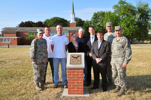At the opening ceremony for a memorial tribute to fallen heroes in July are (l-r) Col. Amanda Gladney, USAF; Brad Zirkle; Joshua Hale; Jo Lynn Anderson; Bert Crain; Casey Weinstein; Aaron Miller; Col. Rob Lyman, USAF; and Chief Master Sgt. John Mazza, USAF.