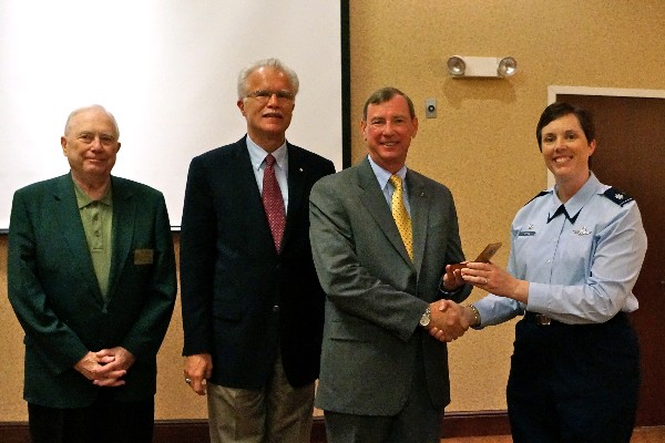Lt. Col. Brenda Oppel, USAF, chapter vice president, programs, presents Brown with the chapter coin in July. Also pictured (l-r) are Fred Scheyd, regional vice president. and Rick Wegmann, chapter board president.