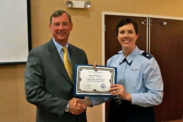Lt. Col. Oppel presents Brown with the chapter's certificate of appreciation for speaking at the July luncheon.