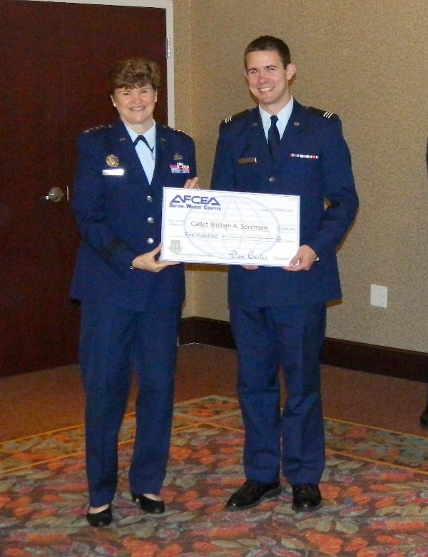 Gen. Wolfenbarger (l) presents a $500 Air Force ROTC scholarship to Cadet Sorenson in October.