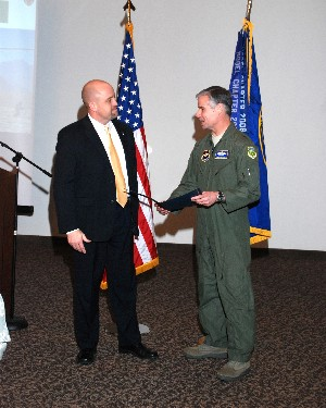 Brig. Gen. Walter D. Givhan, USAF (r), commandant, Air Force Institute of Technology, Wright-Patterson Air Force Base, Ohio, receives a certificate of appreciation from David Hart, chapter president, for speaking at the January meeting.
