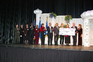 Chapter President Dennis Doucet (2 from r) presents Chapter Vice President of Education Kathy DeMolet with a check for $50,000 at the 2006 AFCEA Infotech Banquet for the Chapter's Scholarship Fund from the proceeds of the conference. Also pictured are members of local colleges and universities who will be receiving financial support from the Chapter.