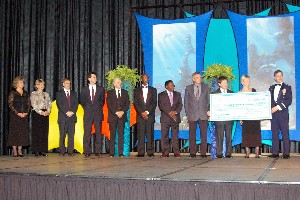 Chapter members and university recipients of scholarship funds gather onstage at the October InfoTech event's black tie banquet in recognition of outstanding achievement and academic merit.