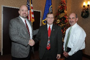 In December, David Hart (l), chapter president, and Dan Curtis (r), chapter vice president for programs, present a token of appreciation to Gerald Freisthler, executive director, Aeronautical Systems Center, Air Force Materiel Command.
