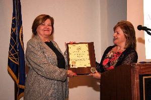 Skinner (r) presents a lifetime membership plaque to Lorna Estep, chair of the chapter's board of directors, in July.