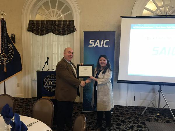 Chapter President Michael Tague presents Kuan Collins, solutions director, SAIC, with a certificate of appreciation at the March meeting.