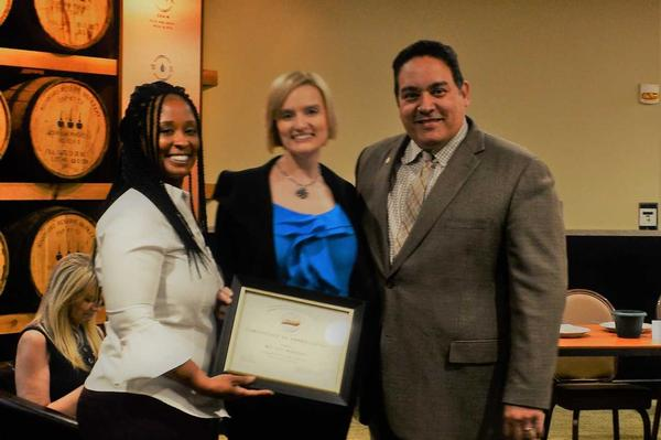 Brittany Robinson, a participant in the May panel (c), receives a certificate from Thompson (l) and Rivera.