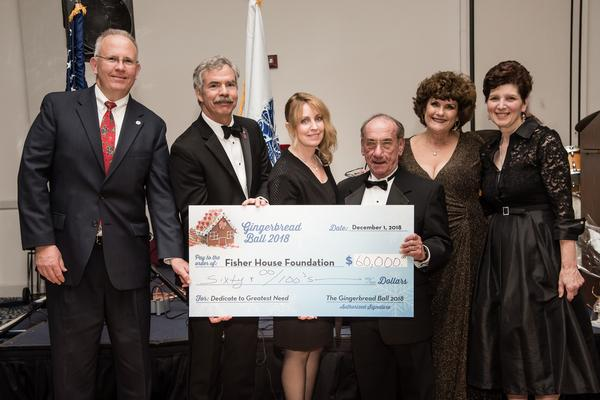 A $60,000 check is presented to Fisher House Foundation at the December 2018 Gingerbread Ball. Presenters are (l-r) Col. Myles Murphy, USAR (Ret.), AOC, Garden State Chapter president; Capt. Brian Gawne, USN (Ret.), Fisher House Foundation, vice president of community relations; Ms. Donna V. Petro, chapter president; Col. Samuel Fuoco, USA (Ret.), AUSA Monmouth president; Kit Roache, chapter vice president of programs and Gingerbread Ball committee chair; Ms. Margaret Tamburri, vice president of NJBBT.