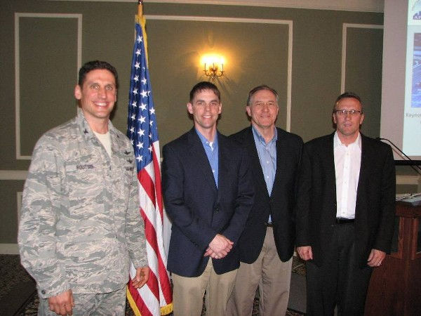Joining together at the April luncheon are (l-r) Col. Donovan L. Routsis, chapter president; Daniel G. Ramaekers, vice president of information technology, Tenaska;  Phillip Narducci, manager of IT infrastructure support, Tenaska; and Brian Schaben, director of IT infrastructure and operations, Black Hills Corporation. Each panelists received a chapter coin for their participation.