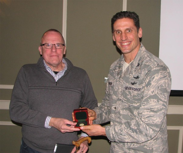 Dr. Kenneth L. Dick, Ph.D., telecommunications chair and senior research fellow, College of Information Science and Technology, University of Nebraska at Omaha, receives a token of appreciation from Col. Donovan L. Routsis, USAF, chapter president, following Dick�s speech on wireless security at the February luncheon.
