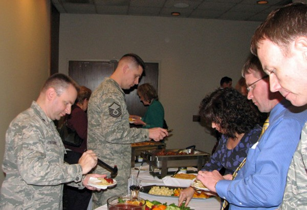 Participants partake in the appetizers at the chapter�s holiday mixer held at the Offutt Air Force Base Patriot Club in December. Several electronic giveaways were distributed during the event, including water bottles adorned with the chapter logo.