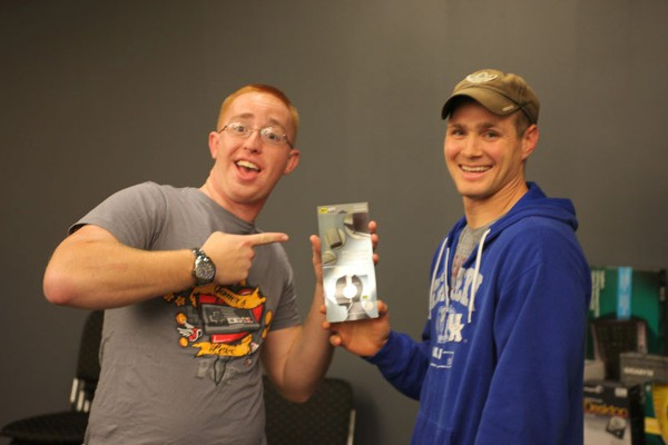 Senior Airman Zachary T. Kerns, USAF (l), SACCS programmer, 55 Strategic Communications Squadron, receives a giveaway from Staff Sgt. Cameron D. Smith, USAF, chapter assistant lead Young AFCEAN. Senior Airman Kerns is just one of the prize recipients who participated in the chapter�s October LAN Party.