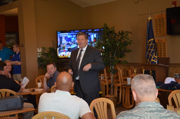 Robert W. Madden, deputy director, Global Shield Program Management Office, U.S. Strategic Command (STRATCOM), Offutt Air Force Base, addresses the chapter�s TechNet Golf Tournament assembly in June on how the new STRATCOM facility is progressing and when it is projected for completion.