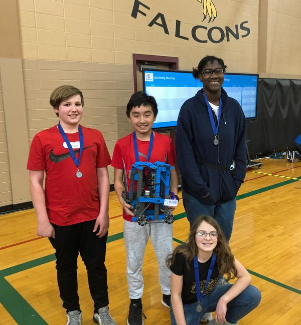 Pictured (l-r) are members of the Logan Fontenelle Middle School Robotics B-Team from Bellevue, Nebraska: Caleb Winterbottom, Nguyen Phan, Martha Hinnen, and Cadence Montgomery (Front). Not pictured is Rachel Byington.
