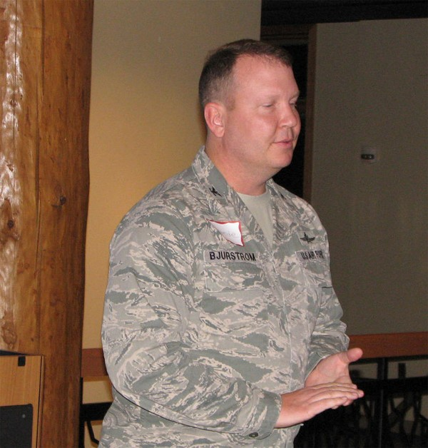 Col. Eric Bjurstrom, USAF, chapter president and commander, Defense Information Systems Agency Field Office at the U.S. Strategic Command, Offutt Air Force Base, Nebraska, provides welcoming remarks for the chapter�s 2nd Holiday Mixer, an event held in December to give back to program sponsors and the membership.