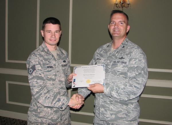 Col. Murphy honors Staff Sgt. Daniel Wyman, USAF, chapter treasurer (l), in October as one of the chapter's AFCEANs of the Month for his support of the 16th annual golf tournament. Also recognized but not pictured was Staff Sgt. Anthony Elia, USAF, for his role as the tournament's lead coordinator.