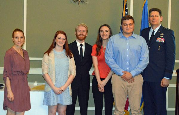Gen. Thompson (r) assists with presenting scholarships to these young people at the chapter's April luncheon.