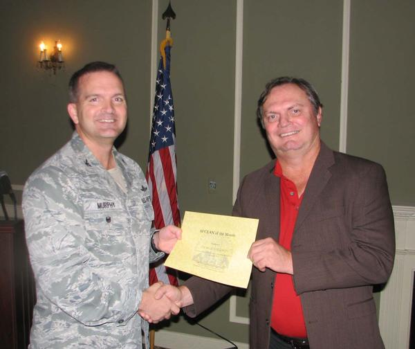 Col. Murphy recognizes Charlie Callison, chapter secretary, as the chapter's AFCEAN of the Month for his role as golf coordinator for the chapter's 17th golf tournament during the luncheon in October.