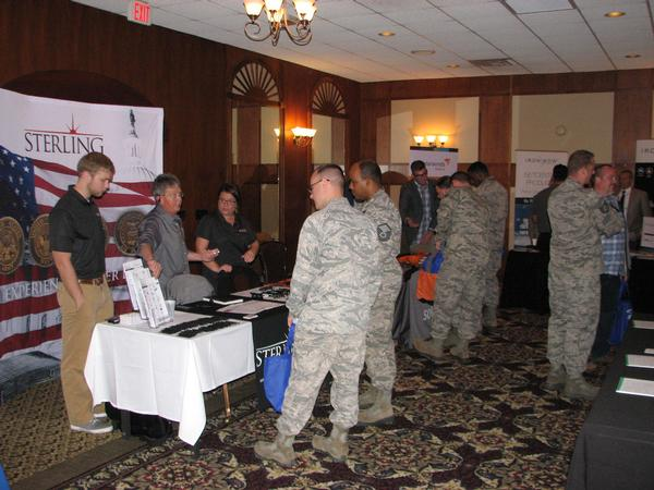 Attendees visit one of 39 exhibit booths at the Heartland Tech Expo in October.