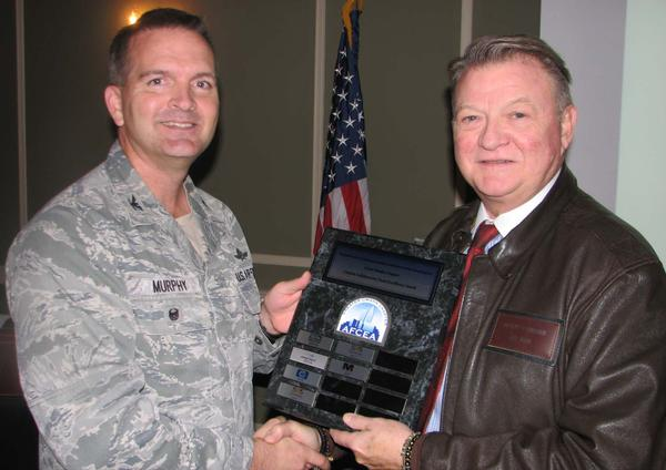 Col. Murphy presents Jeffrey Wilke, M2 Technology, and The Offutt Advisory Council, Omaha NE, with the Carpino Collaborative Team Excellence award for the 2017-2018 term. The award acknowledges the program sponsor that best demonstrates volunteerism, participation, initiative and citizenship throughout the program year.