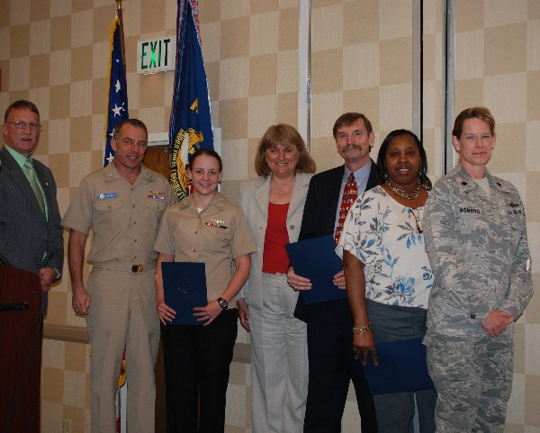 Together at the April meeting are (l-r) Vanderlip; Rear Adm. Terry Kraft, USN, commander, Navy Warfare Development Command; Petty Officer Third Class Mclelland; Duvall; Dr. John Wittman, AFCEAN of the Month; Teresa Irons, Civilian Cyber Professional of the Month; and Lt. Col. Jenniffer Romero, USAF, chapter member.