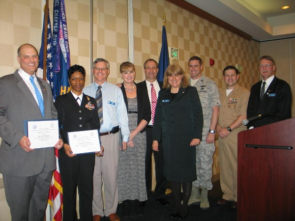 In March, the chapter recognizes awardees (l-r) Pete DiPaola, AFCEAN of the Month (February 2013); Petty Officer First Class Renee Watkins, USN, Military Cyber Professional of the Month; Dr. James Pasch, AFCEAN of the Month; Mrs. Bos alongside her husband Jon Bos, Civilian Cyber Professional of the Month; while Duvall; Col. Messer; Lt. Cmdr. Dave Pereira, USN, chapter vice president of military affairs; and Doug Vanderlip, chapter executive vice president, stand witness.