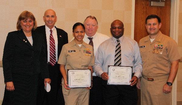 Teresa Duvall (l), chapter president, recognizes November award recipients Lt. j.g. Taysha Colon, USN, Military Cyber Professional, and Carlos Parker (2nd from r), Civilian Cyber Professional, while Walker (2nd from l), Alan Rickman and Lt. Cmdr. Dave Pereira, USN, chapter vice president of military affairs, stand witness.