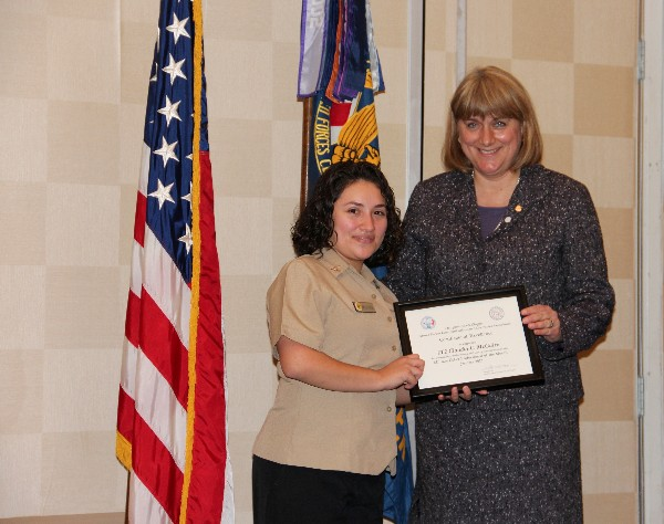 Teresa Duvall, chapter president, presents the January Military Cyber Professional Award to Petty Officer Second Class Claudia C. McGuire, USN, Naval Computer Telecommunications Area Master Station, Atlantic.