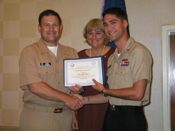 Lt. Cmdr. David Pereira, USN (l), chapter vice president, and Duvall present the August Military Cyber Professional of the Month Award to Petty Officer 1st Class Eric Koss, USN, commander, Submarine Force, U.S. Atlantic Fleet.