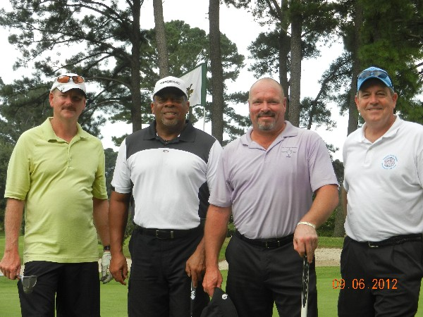 Afternoon golfers at the chapter�s charity tournament in September are Steve, J.R., Mel and Palmer.