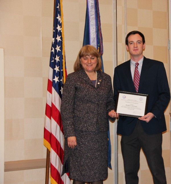 Duvall presents the January Civilian Cyber Professional Award to Matt Liberman of the Old Dominion University Student Chapter.
