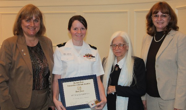 Duvall (l) and Mary Yager (r), chapter vice president for education, attend the Hampton Roads Navy ROTC Ceremony in April, where they present the AFCEA ROTC Honor Award to officer candidate Yolanda Quinones, Navy ROTC, while Dr. Linda L. Vahala, associate dean, Frank Batten College of Engineering and Technology, stands witness.