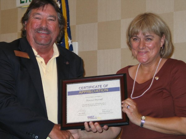 Steve Kelley, regional vice president, presents Duvall with a certificate of appreciation for her accomplished tenure as chapter president and for her coordination of the EAST Joint Warfighting 2013 Cyber Engagement Theater.