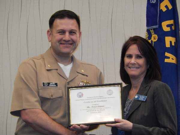 Lt. Cmdr. Dave Pereira, USN (l), chapter Young AFCEAN chair, awards Treci Dimas with the February AFCEAN of the Month Award.