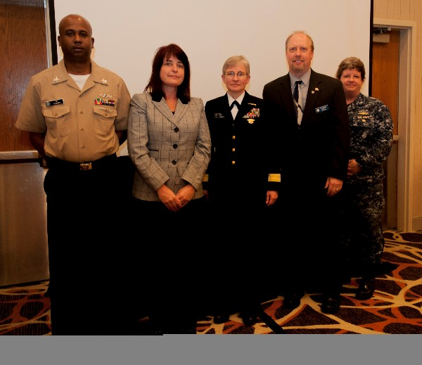 Together at the March luncheon are (l-r) Information Systems Technician 1st Class Corey Walker, USN, Military Cyber Professional of the Month; Tracy Carroll, Civilian Cyber Professional of the Month; Rear Adm. Diane Webber, USN, commander, U.S. Navy Cyber Forces and guest speaker; and Larry Minnick, chapter vice president and AFCEAN of the Month.