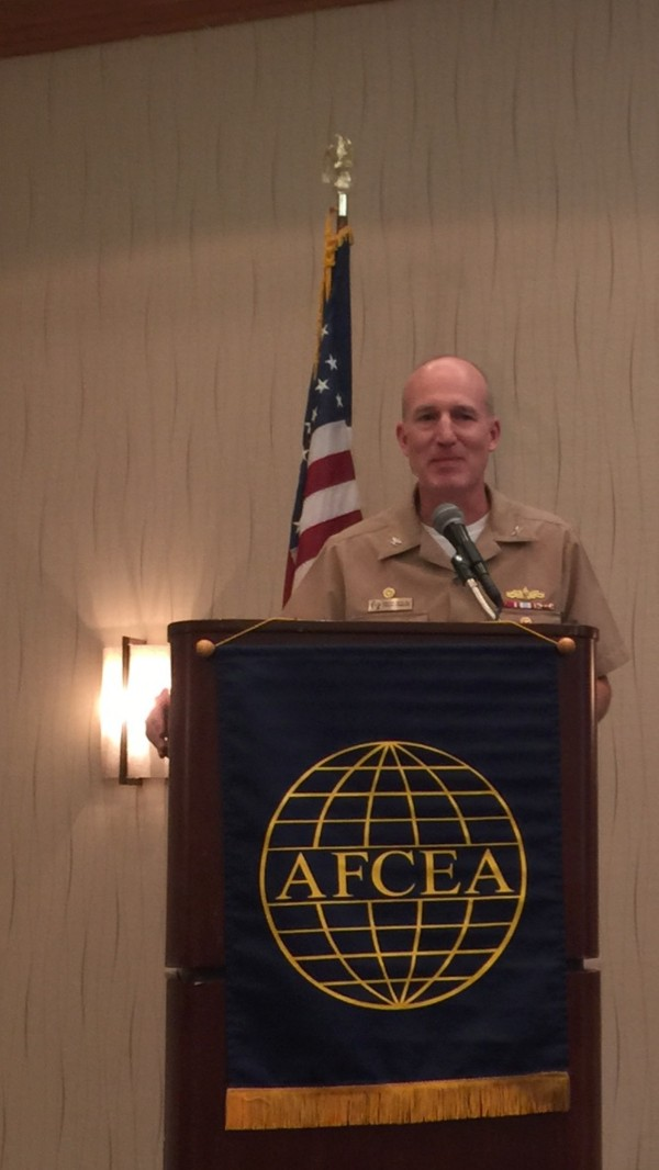 Capt. Kevin Hill, USN, commander, Afloat Training Group Atlantic, speaks at the June luncheon.