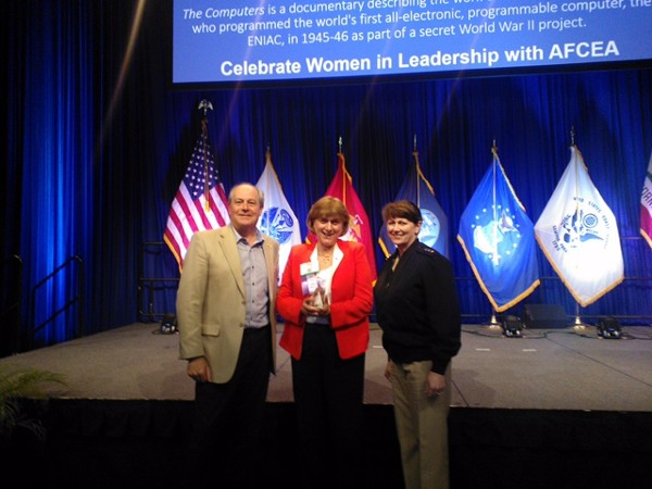 Representing the chapter, Teresa Duvall (c), receives her Women's Appreciation Award during the 2016 AFCEA West Conference in March in San Diego along with Palmer Sims (l) and Vice Adm. Jan Tighe, USN.