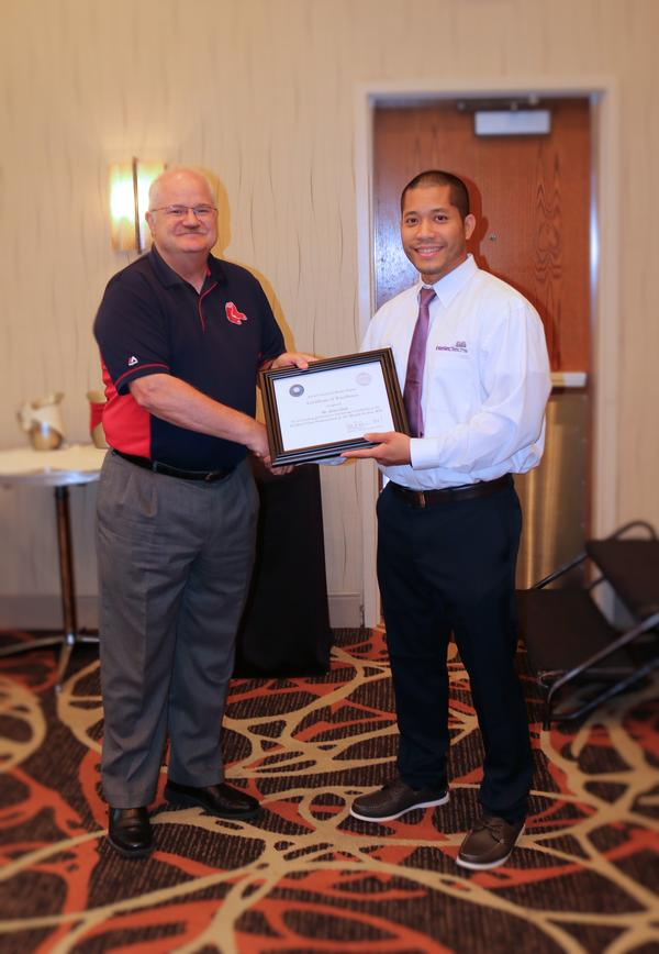At the July luncheon, Neil Bourassa, chapter president, presents Brian Dinh, IntellecTechs (r), with an award for Civilian Cyber Professional of the Month.